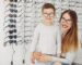 Mother with cute son. Family buy glasses